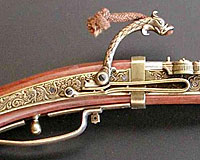 Early firearms included this matchlock design